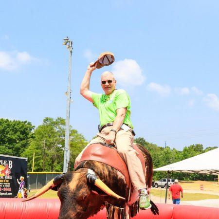 Dreamgate Events - Community - Pelham Mayor Riding Bull at Pelham Palooza